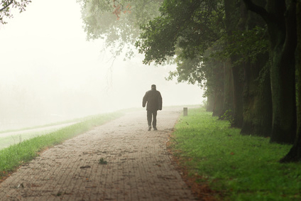 Old man walk into the fog